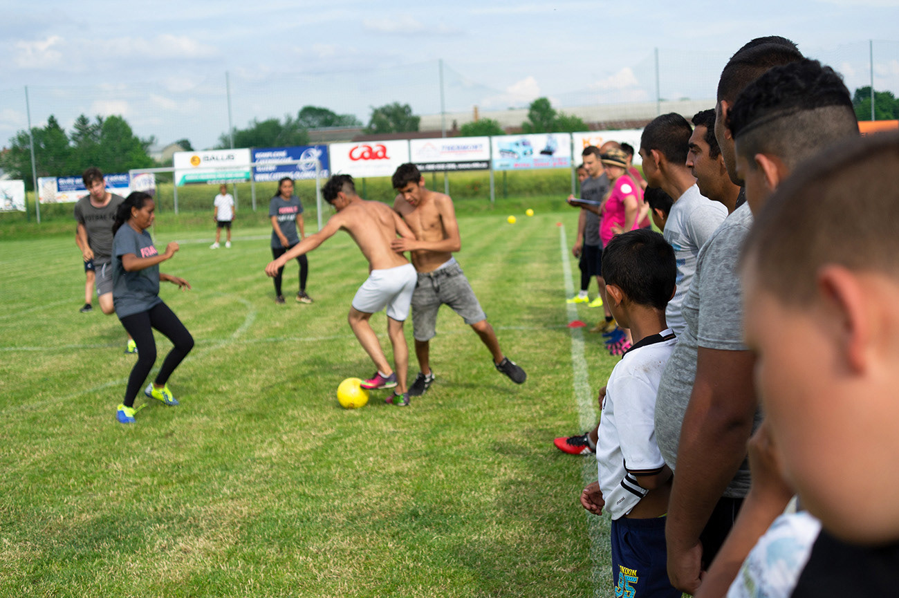 Players are playing football, sport game is watched by viewers, Action day, Olomouc, Czech Republic
