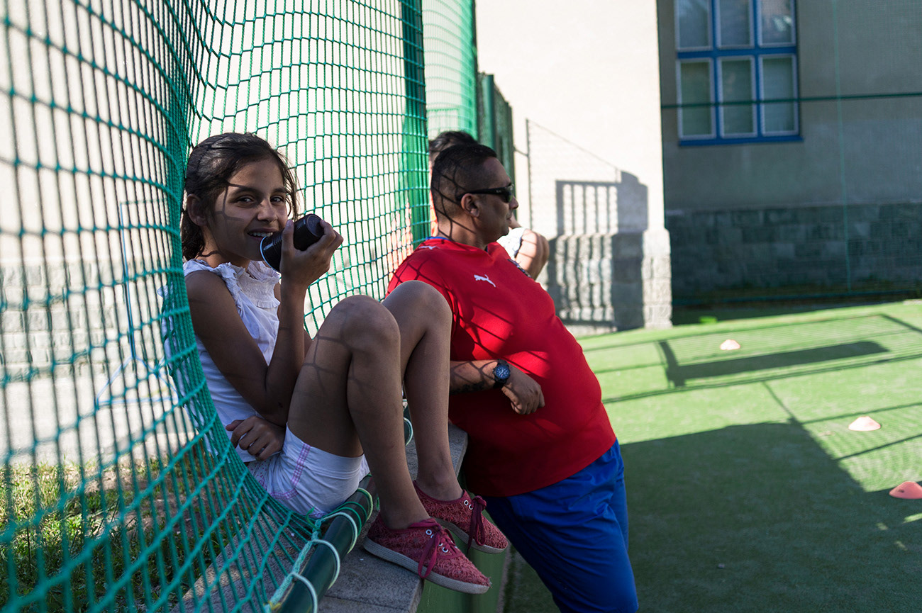 Young child and man are watching football match, Action day, Ústí nad Labem, Czech Republic