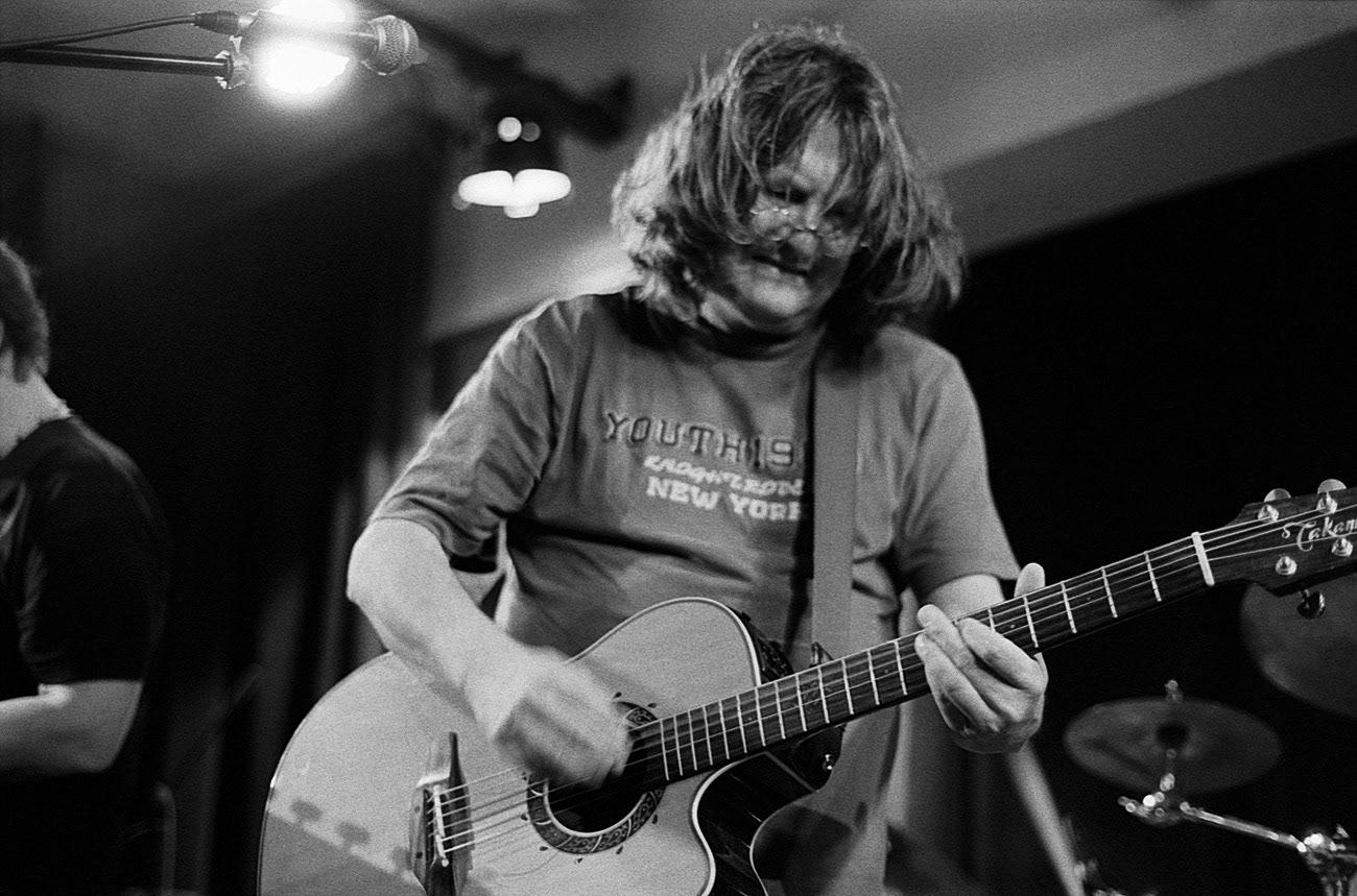 Concert photograph of male singer and musician guitarist on the stage, Ivan Hlas, Ivan Hlas Trio, Klub Parník, Ostrava, Czech Republic