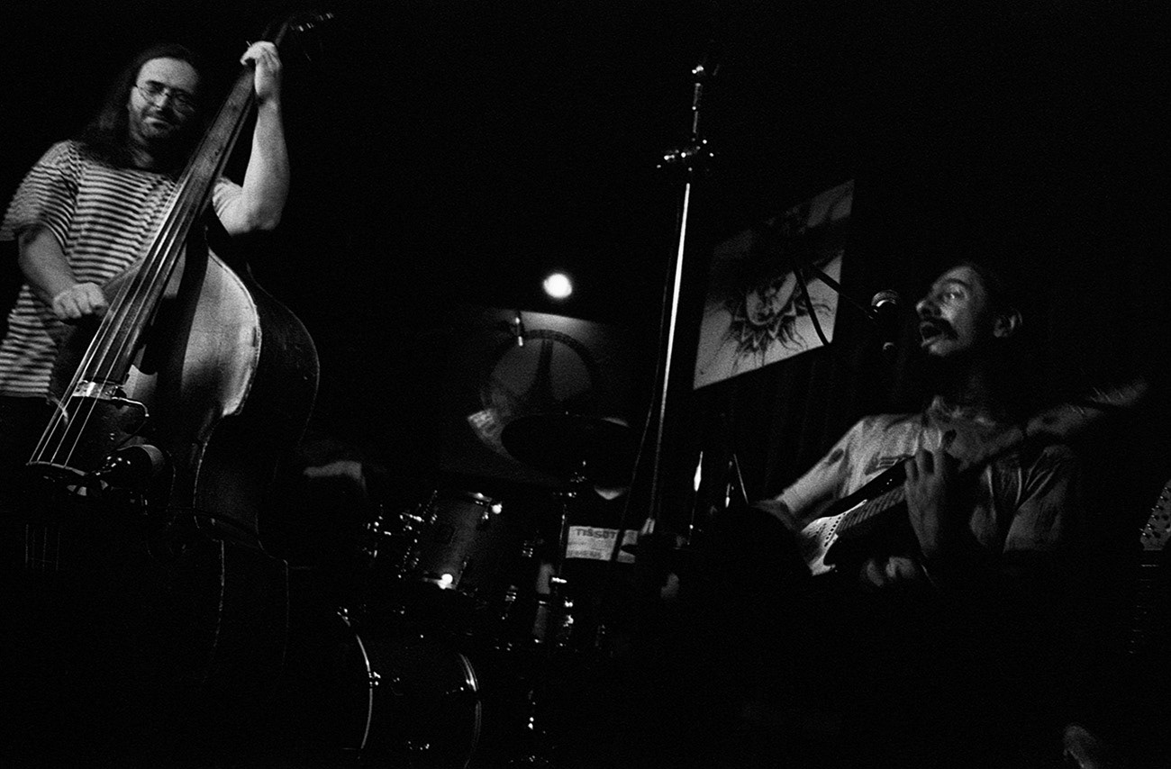 Concert photograph of male musician and singer on the stage, Ladislav Červenák, Norbert Červenák, ZVA 12−28 band, Klub Hudební bazar, Ostrava, Czech Republic
