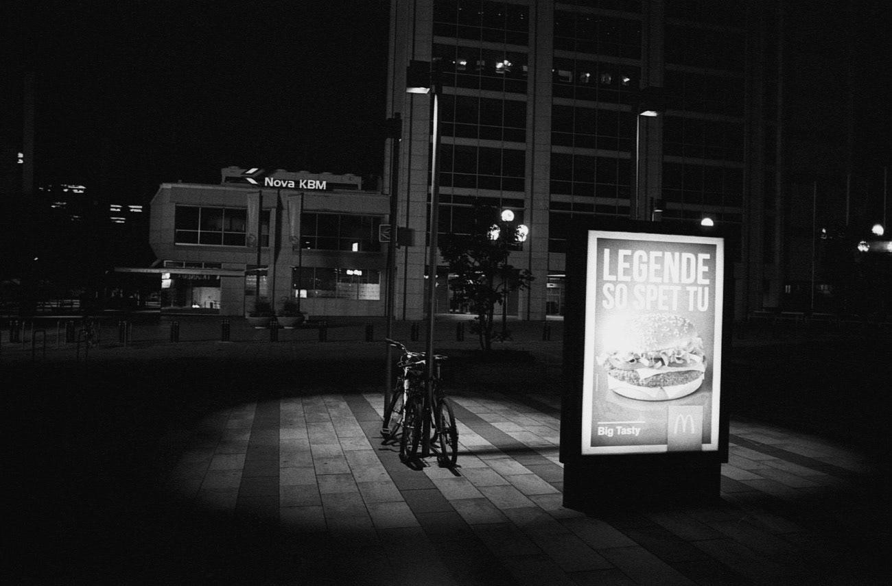 McDonalds advertisement in the street at night, Leon Štukelj square, Maribor, Slovenia