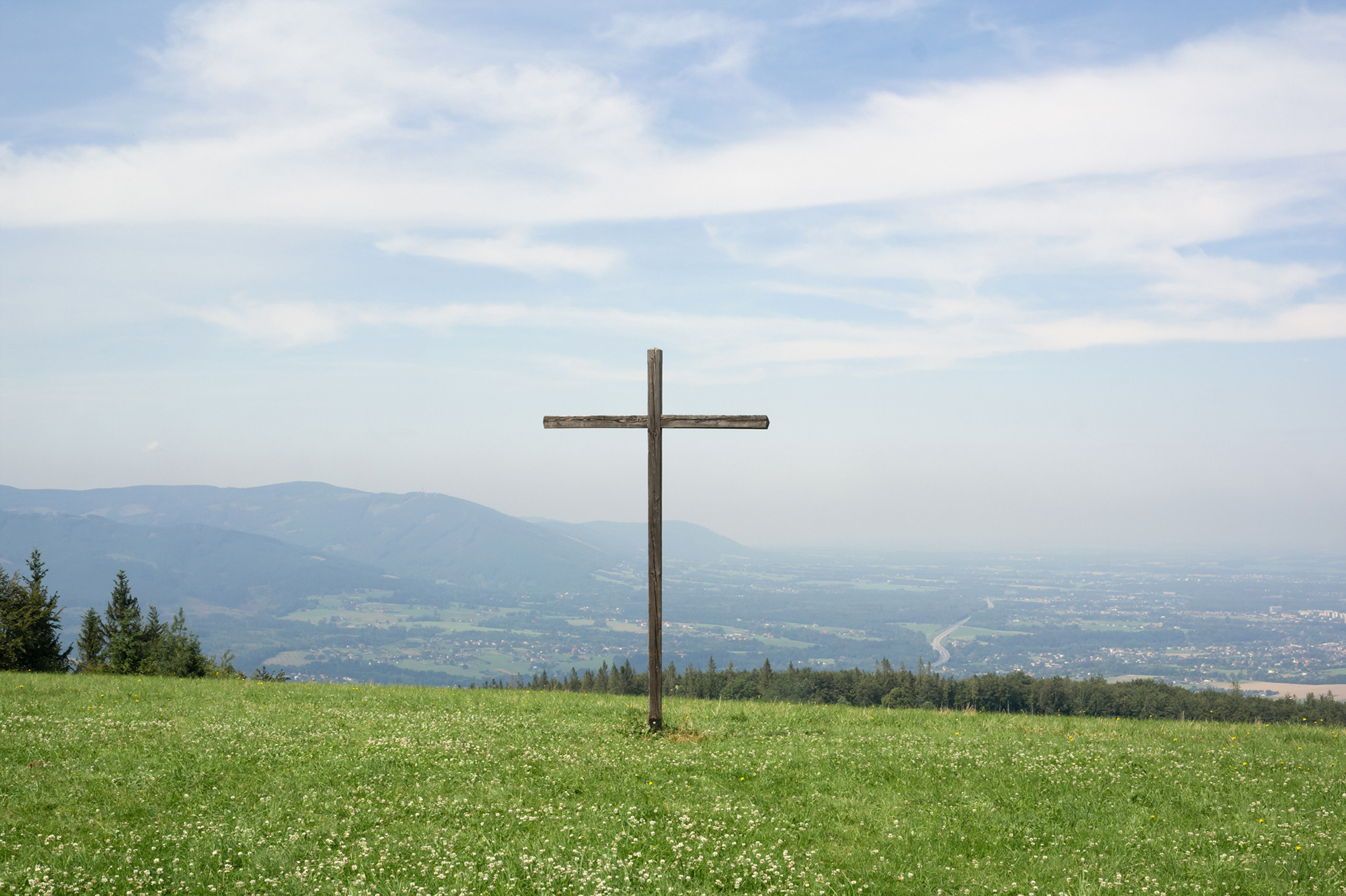 Christian cross and crucifix made of wood. Religious symbol in nature. Loučka, Beskid mountains, Czech Republic