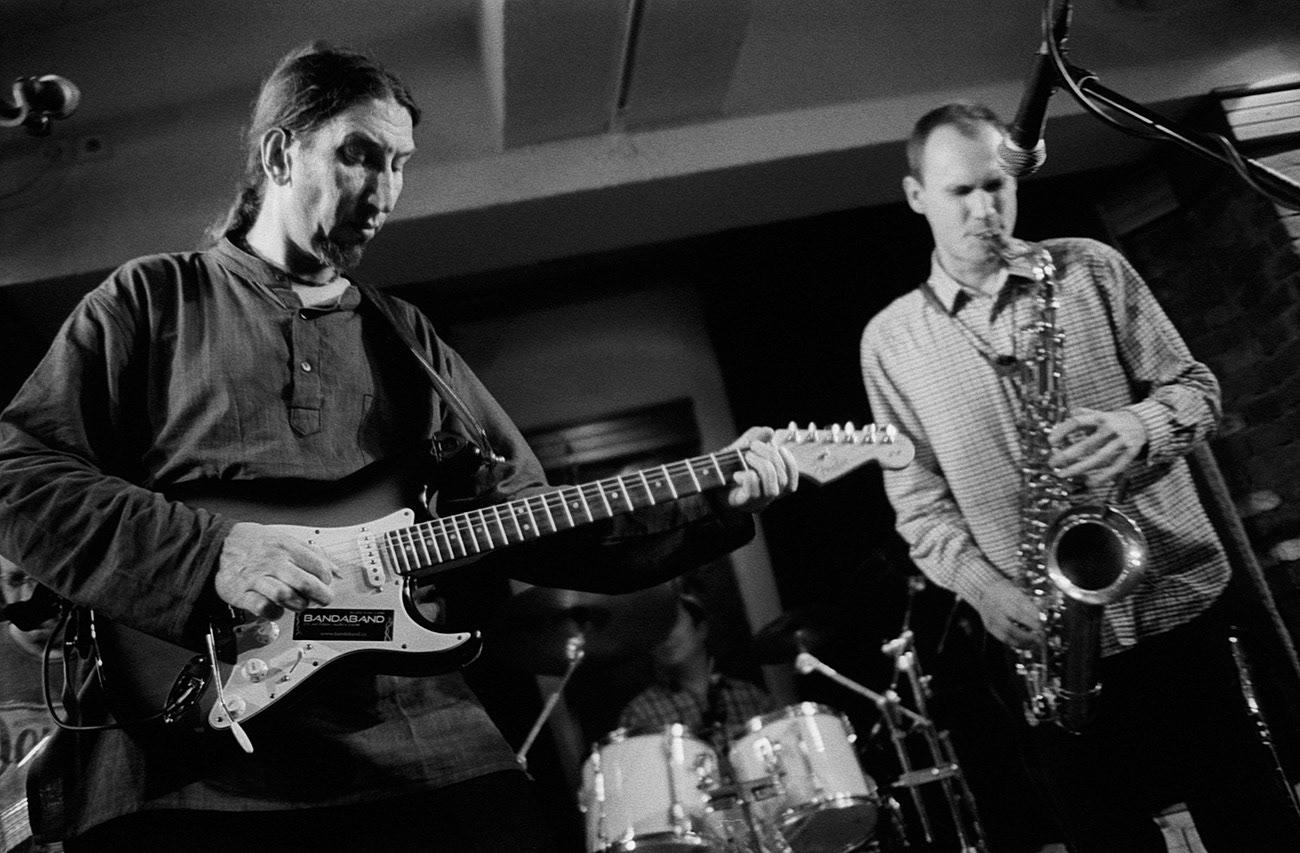Concert photograph of two male musicians on the stage, Martin Rek, Tomáš Zetek, Bandaband, Klub Parník, Ostrava, Czech Republic