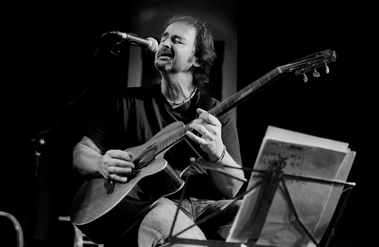 Concert photograph of male musician and guitarist on the stage, Norbi Kovács, Skoumal & Nejezchleba & Kovács, Klub Parník, Ostrava, Czech Republic
