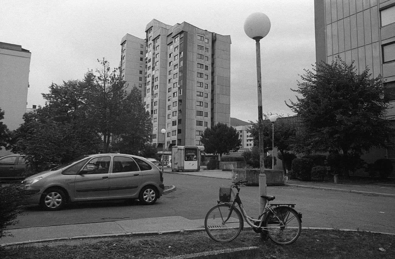 Bike and cars in the city and town street, Nova Vas, Maribor, Slovenia