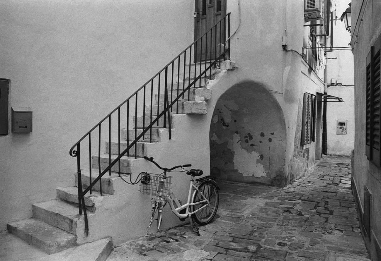 Bike with missing wheel on the street of old mediterranean city and town, Piran, Slovenia