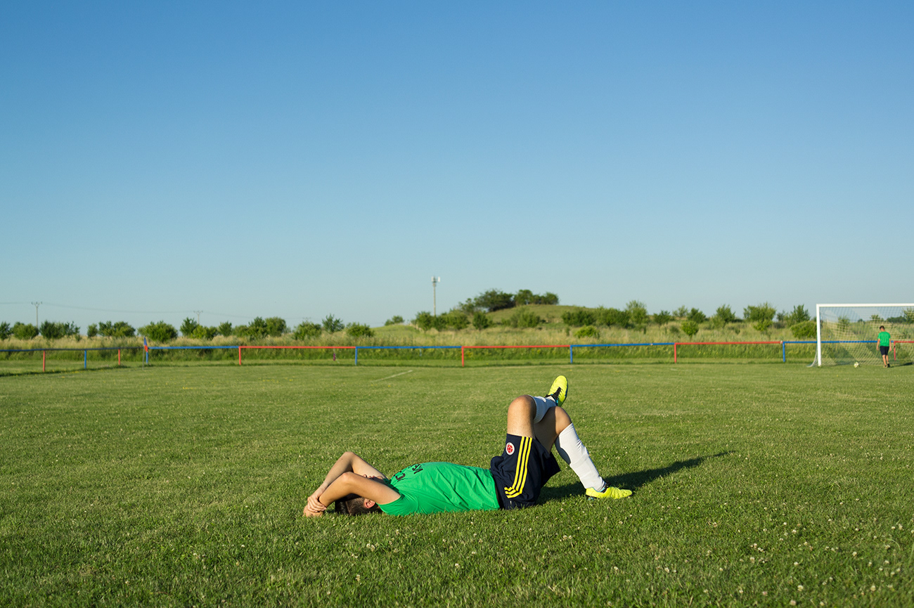 Lying man on the football pitch, Relaxing after friendly match with local team, Nepomyšl, Czech Republic