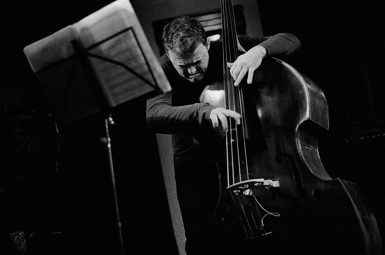 Concert photograph of male musician and bassist on the stage, Robert Balzar, Robert Balzar Trio, Klub Parník, Ostrava, Czech Republic