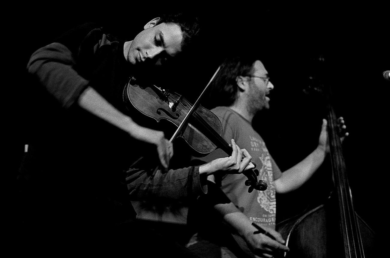 Concert photograph of male musician and violinist on the stage, Stanislav Fakan, ZVA 12−28 band, Klub Hudební bazar, Ostrava, Czech Republic