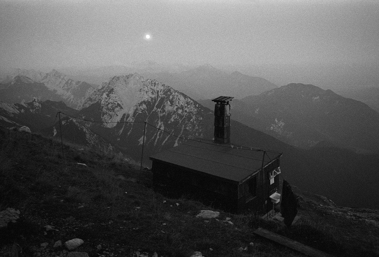 Landscape photograph of toilet building and mountains at late evening, Stol, Karavanks, Slovenia