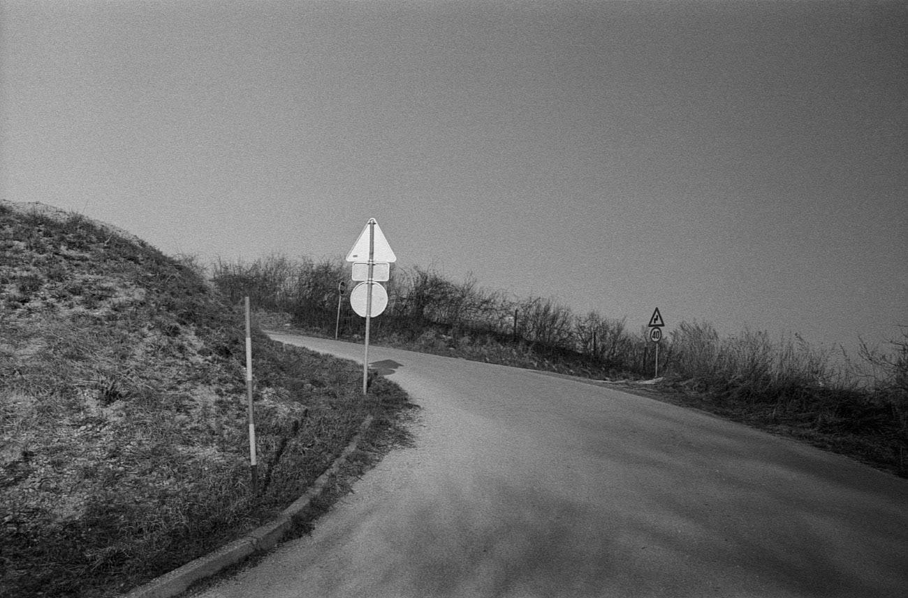 Traffic sign and road, Stolni Vrh, Maribor, Slovenia