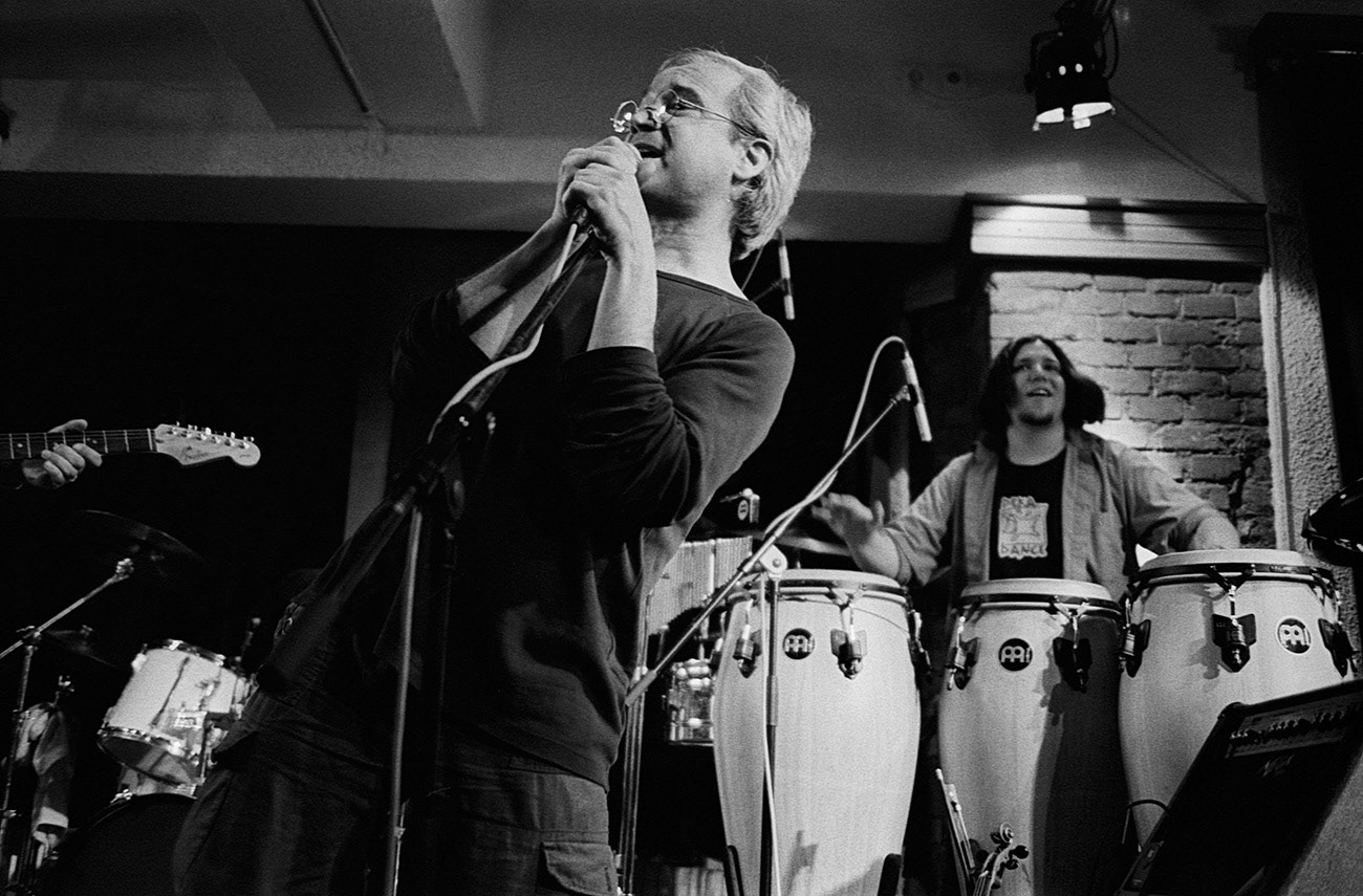 Concert photograph of male musician and singer on the stage, Vladislav Georgiev, Adam Rek, Bandaband, Klub Parník, Ostrava, Czech Republic