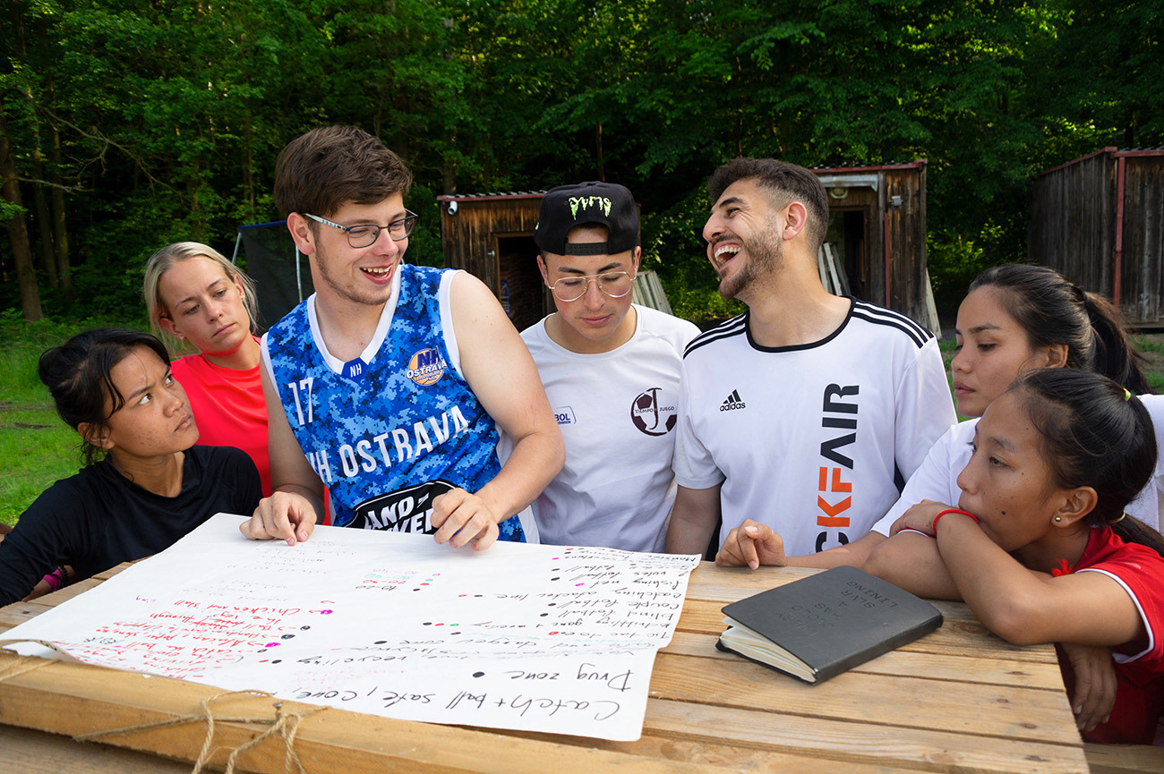 Young adults are smiling during preparation of programme, training, Lanškroun, Czech Republic