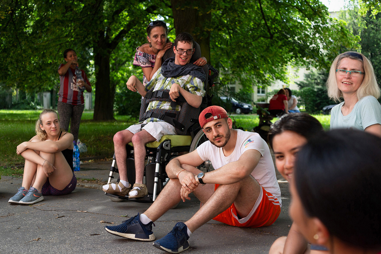 Young people are sitting in the circle and listening, workshop with local people with disabilities, Brána integration centre, Ostrava, Czech Republic